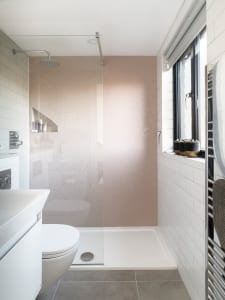 Bathroom in a loft conversion with pink tiles