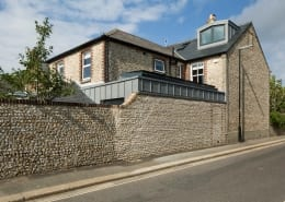 zinc clad extension with flint wall
